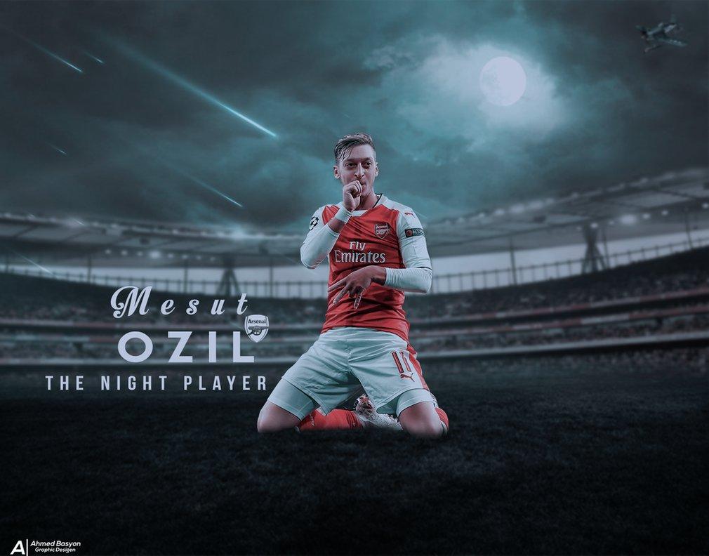 Ozil celebration knees